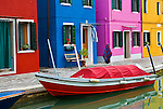 Colourful Houses on the lagoon island of Burano in Venice, Italy. The island is known for its lacework and brightly coloured homes. Burano is situated 7 kilometres (4 miles) from Venice,