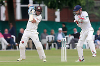 Scott Borthwick of Surrey in batting action as James Foster looks on from behind the stumps during Surrey CCC vs Essex CCC, Specsavers County Championship Division 1 Cricket at Guildford CC, The Sports Ground on 11th June 2017