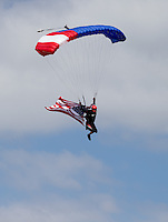 Aug. 4, 2013; Kent, WA, USA: A skydiver brings in the American flag at the opening ceremonies for the NHRA Northwest Nationals at Pacific Raceways. Mandatory Credit: Mark J. Rebilas-USA TODAY Sports
