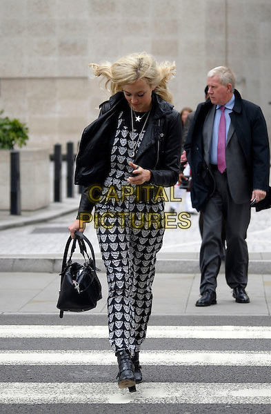 Fearne Cotton leaving BBC Radio 1, London, England.<br /> 11th September 2013<br /> full length black white print pattern fox animal jacket leather bag purse print jumpsuit mobile phone texting <br /> CAP/IA<br /> &copy;Ian Allis/Capital Pictures