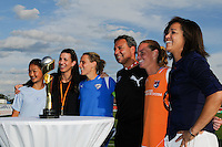 A fan poses for photos with the 1999 FIFA Women's World Cup Trophy and Sara Whalen, Saskia Webber, Kristine Lilly, Tony DiCicco, and Christie Rampone. Sky Blue FC defeated the Boston Breakers 1-0 during a Women's Professional Soccer match at Yurcak Field in Piscataway, NJ, on July 4, 2009.