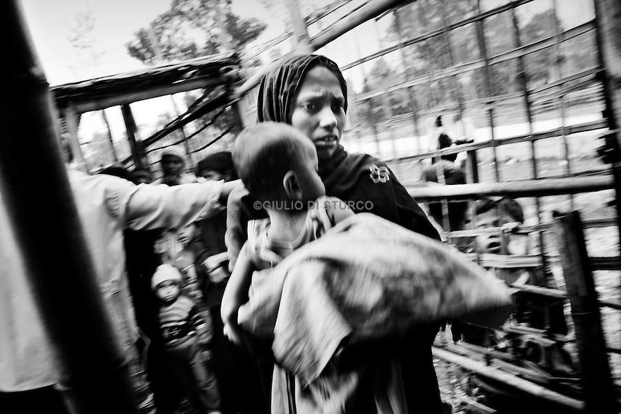 Rohingya, a Muslim ethnic minority originating from Myanmar where they are denied citizenship and suffer persecution and discrimination. Over the past two decades, hundreds of thousands of people have fled their homes to seek refuge abroad, however, few have been granted refugee status and most of them are unrecognized and unassisted. Thousands of unregistered Rohingya refugees live in the Kutupalong makeshift camp, Bangladesh. They are being forcibly displaced from their homes, in an act of intimidation and abuse by the local authorities, the international medical organization Medecins Sans Frontieres (MSF) has treated numerous people for injuries where the majority were women and children.A fundamental solution for the Rohingya, not only in countries where they seek asylum but at their origin, is crucial to restoring the health and dignity of these long suffering people. December 17 2009, Msf clinic operating for the unregistred Rohingya living in Kutupalong makeshift camp, Cox's Bazar, Bangladesh