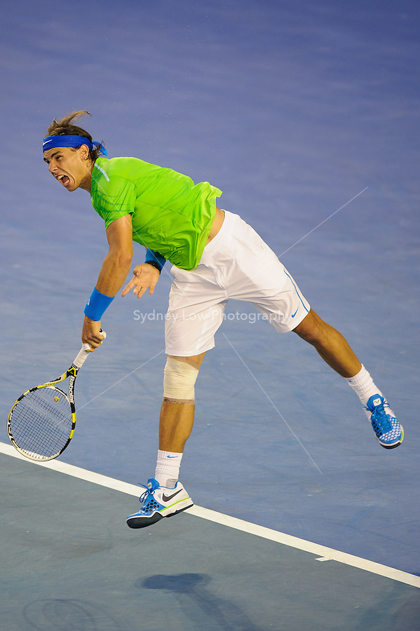 MELBOURNE, 24 JANUARY - Rafael Nadal (ESP) hits a serve against Tomas Berdych (CZE) during a men's quarterfinals match on day nine of the 2012 Australian Open at Melbourne Park, Australia. (Photo Sydney Low / syd-low.com)