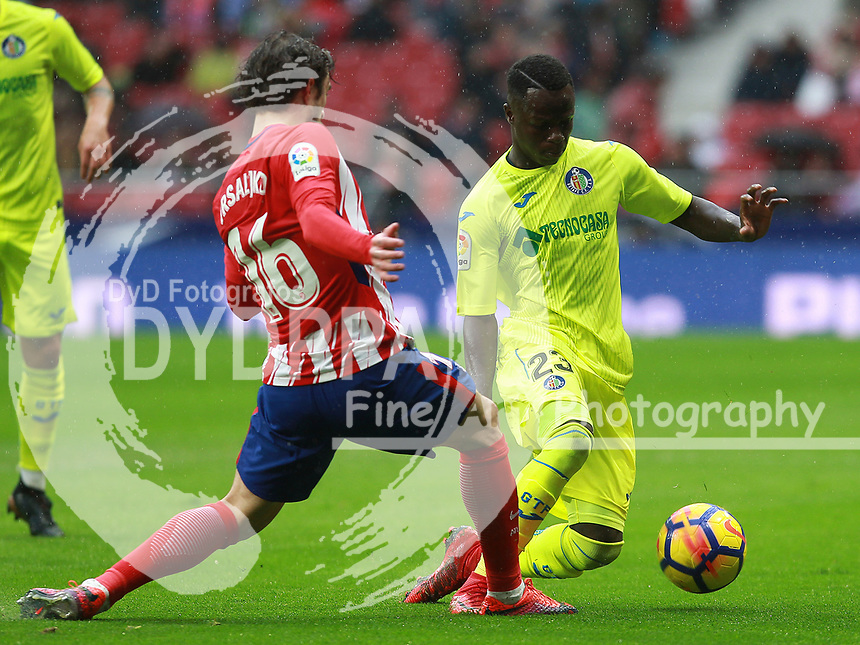 Atletico Madrid's Croatian defender Sime Vrsaljko: Getafe's player Amath<br /> <br /> Atletico de Madrid vs Getafe Spanish League football match, La Liga Santander, at Wanda Metropolitano stadium in Madrid on January 6, 2017