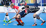 LONDON -  Unibet Eurohockey Championships 2015 in  London. Germany v France . Christopher Wesley (r) with French Tom (C) Genestet  .WSP Copyright  KOEN SUYK