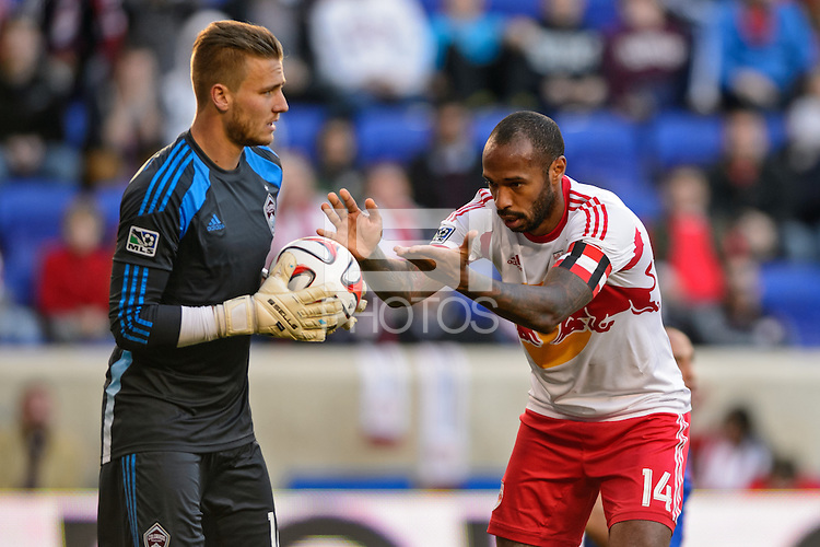 Thierry Henry (14) of the New York Red Bulls hands the ball to Colorado Rapids goalkeeper John Berner (12) late in the second half. The New York Red Bulls and the Colorado Rapids played to a 1-1 tie during a Major League Soccer (MLS) match at Red Bull Arena in Harrison, NJ, on March 15, 2014.