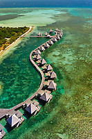 Aerial view of bungalows, L'Escapade Island Resort, Wing Island, on the New Caledonia Barrier Reef (the second longest double-barrier reef in the world, a UNESCO World Heritage Site) off Noumea on Grand Terre, New Caledonia.