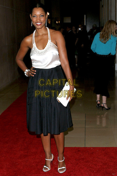 GARCELLE BEAUVAIS-NILON.Women In Film presents Fusion, The 2005 Crystal and Lucy Awards An Evening Celebrating Partnership held at the Beverly Hilton, Beverly Hills, CA, USA, .10th June 2005..full length white halterneck top black skirt clutch bag.Ref: ADM.www.capitalpictures.com.sales@capitalpictures.com.©Jacqui Wong/AdMedia/Capital Pictures.