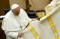"Papa Francesco riceve un poncho durante l'udienza con i partecipanti all'Incontro Mondiale dei Dirigenti di Scholas Occurentes, nell'Aula del Sinodo, Citta' del Vaticano, 4 settembre 2014.<br /> Pope Francis receives a poncho during his audience to participants in the ""Scholas Occurentes"" executives world meeting, at the Vatican, 4 September 2014.<br /> UPDATE IMAGES PRESS/Riccardo De Luca<br /> <br /> STRICTLY ONLY FOR EDITORIAL USE"