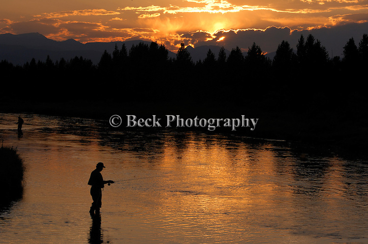 Fly fishing the Madison River in Montana at dusk.
