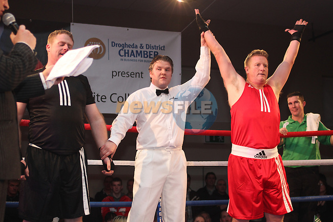 "Robbie Sweeney ""Raging Robbie"" (red) sponsored by Learn About Shares and Chris Lennon ""Big Bang Lennon"" (black) sponsored by Outsource taking part in Drogheda and District, ""Battle of the Barbican"" White Collar Boxing Event in aid of the Des Smyth Foundation...(Photo credit should read Jenny Matthews www.newsfile.ie)....This Picture has been sent you under the conditions enclosed by:.Newsfile Ltd..The Studio,.Millmount Abbey,.Drogheda,.Co Meath..Ireland..Tel: +353(0)41-9871240.Fax: +353(0)41-9871260.GSM: +353(0)86-2500958.email: pictures@newsfile.ie.www.newsfile.ie."