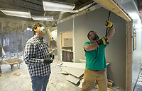Hunter Bailey (right), Christ Community Church lead pastor, and church member Chris Berry help Saturday, Jan. 11, 2020, while doing interior demolition with other church members at 101 W. Mountain Street on the Fayetteville square.  <br /> <br /> Christ Community Church purchased the building and will work with Milestone Construction Company to renovate the space into their permanent home. Art Ventures NWA moved out of the building in December and the Fayetteville Farmers Market will keep their office in the building. <br /> <br /> The church formed six years ago, said Andrew Brill, director of operations, and currently rents space at Mount Sequoyah Retreat and Conference Center. They hope to move into the new space in August. <br /> <br /> The church uses multiple spaces spread across the Mount Sequoyah campus, said Brill, and they wanted a location with everything under one roof. Brill and Bailey both said that the church wanted to be closer to the heart of Fayetteville. Bailey said that he wants people to know the building is 'Still a community place - a place that serves Fayetteville.' <br /> <br /> Check out nwaonline.com/200112Daily/ for today's photo gallery.<br /> (NWA Democrat-Gazette/Ben Goff)