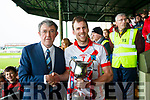 An Ghaeltacts captain Colm Ó Mhuircheartaigh accepting the Munster Intermediate Cup from the Vice Chairman of the Munster GAA, Liam Lenihan.