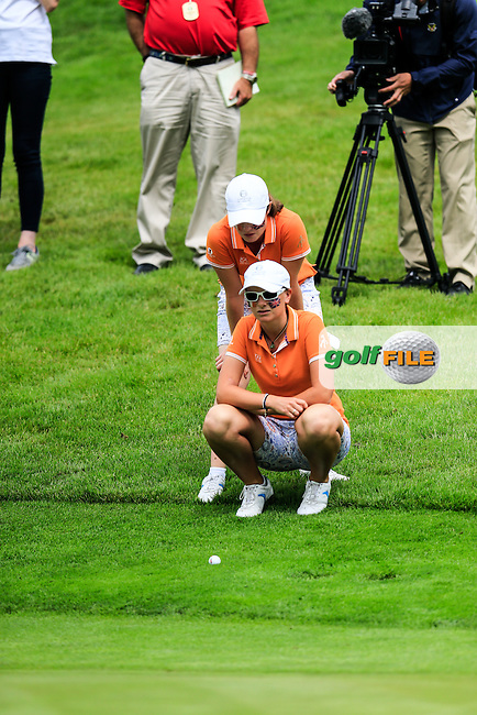Leona Maguire and Charlotte Thomas on the 18th during the Saturday morning foursomes at the 2016 Curtis cup from Dun Laoghaire Golf Club, Ballyman Rd, Enniskerry, Co. Wicklow, Ireland. 11/06/2016.<br /> Picture Fran Caffrey / Golffile.ie<br /> <br /> All photo usage must carry mandatory copyright credit (&copy; Golffile | Fran Caffrey)