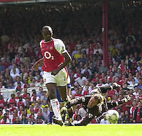 Photo. © Peter Spurrier/Intersport Images.15/05/2004  - 2003/04 Premiership Football - Arsenal v Leicester City:.Patrick Vieira, puts it beyond doubt, beat Ian Walker to score second and winner.[Credit] Peter Spurrier Intersport Images