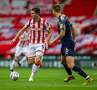 4th July 2020; Bet365 Stadium, Stoke, Staffordshire, England; English Championship Football, Stoke City versus Barnsley; Sam Vokes of Stoke City looks to pass the ball