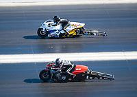 Nov 3, 2019; Las Vegas, NV, USA; NHRA pro stock motorcycle rider Eddie Krawiec (near) against Kelly Clontz during the Dodge Nationals at The Strip at Las Vegas Motor Speedway. Mandatory Credit: Mark J. Rebilas-USA TODAY Sports