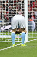 Sergio Aguero of Manchester City looks dejected after missing a chance to score in the first half of extra time during the Capital One Cup match between Liverpool and Manchester City at Wembley Stadium, London, England on 28 February 2016. Photo by David Horn / PRiME Media Images.