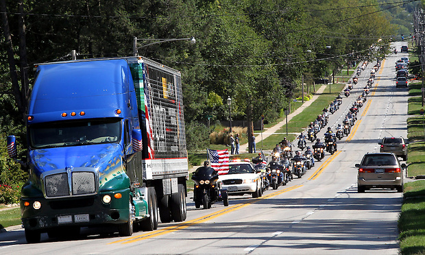 The Dignity Memorial Vietnam Wall --- a traveling, three-quarter-scale replica of the Vietnam Veterans Memorial in Washington, D.C., arrives in a semi with a motorcycle escort in West Des Moines on Sept14, 2011.  The traveling memorial will be open to school children on Thursday and be open to the public at Resthaven Cemetery in West Des Moines from Friday to Sunday. The faux-granite replica is 240 feet long, eight feet high and contains the names of more than 58,000 Americans who died or are missing in Vietnam. More than 30,000 people are expected to see the display while it is in West Des Moines.  (Christopher Gannon/The Des Moines Register)