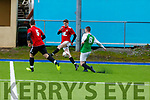 Shane Conway of Abbeydorney's and David Townsend of Manor West FC in action in the Denny soccer league in Mounthawk Park on Sunday