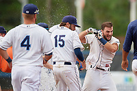 Charlotte Stone Crabs Connor Hollis (right) celebrates with teammates after hitting a walk-off double during a Florida State League game against the Bradenton Maruaders on August 7, 2019 at Charlotte Sports Park in Port Charlotte, Florida.  Charlotte defeated Bradenton 3-2 in the second game of a doubleheader.  (Mike Janes/Four Seam Images)