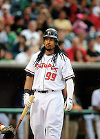 Jun. 23, 2009; Albuquerque, NM, USA; Albuquerque Isotopes outfielder Manny Ramirez bats in the fourth inning against the Nashville Sounds at Isotopes Stadium. Ramirez is playing in the minor leagues while suspended for violating major league baseballs drug policy. Mandatory Credit: Mark J. Rebilas-