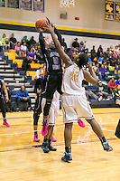 Cedar Ridge's Lashann Higgs attempts to shot over Stony Point's Jordan Moore Friday at Stony Point Gym.  (LOURDES M SHOAF for Statesman)