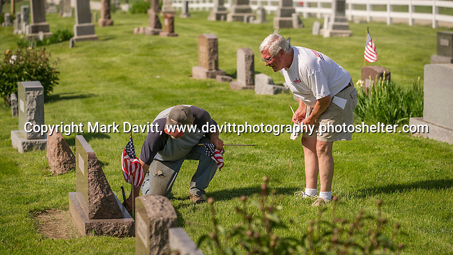 Bob Cassady and Jim Wiedmann check and double check each veteran layer-to-rest in the Calvary Cemetery located west of Churchville are properly documented and each grave decorated in preparation for Memorial Day.