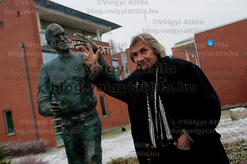 Sculptor Erno Toth with his latest work during the inauguration ceremony of the first ever life-size bronze statue of late Apple leader Steve Jobs in Budapest, Hungary on December 21, 2011. ATTILA VOLGYI