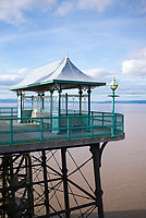 The ancient Victorian pier on stilts on east shore of the Severn Estuary at Clevedon in Somerset