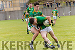 Castlegregory Micheal Ó Scannlain tackled by Lios Póil Roibeard Ó Suilleabhain during the Junior Club Championship Round 2 match at Lispole GAA grounds on Sunday afternoon.