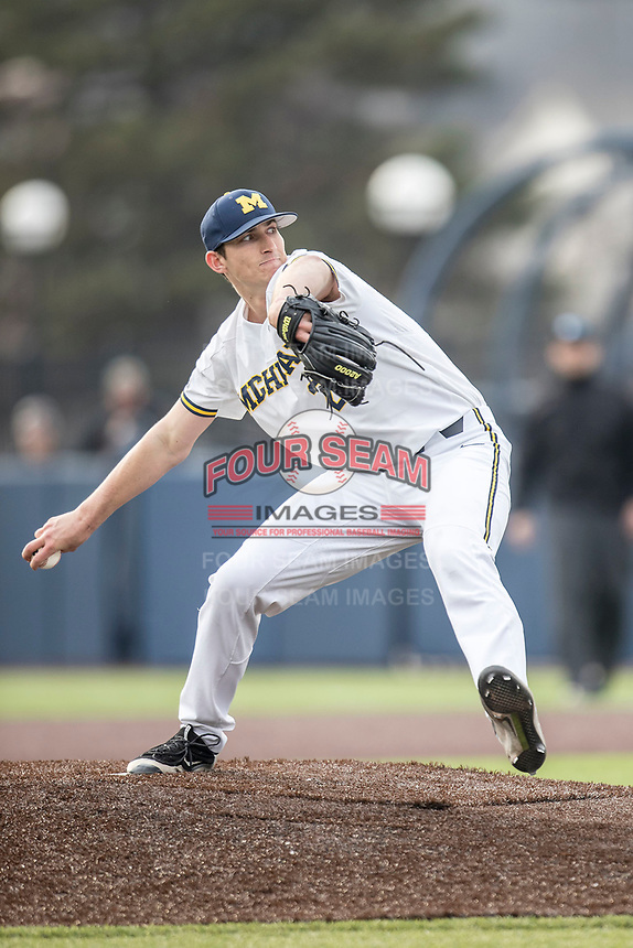 Michigan Wolverines pitcher Troy Miller (27) delivers a pitch to the plate against the Maryland Terrapins on April 13, 2018 in a Big Ten NCAA baseball game at Ray Fisher Stadium in Ann Arbor, Michigan. Michigan defeated Maryland 10-4. (Andrew Woolley/Four Seam Images)