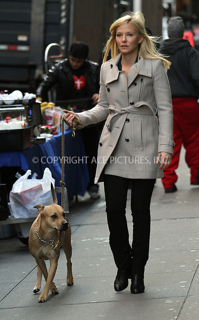 WWW.ACEPIXS.COM......December 13 2012, New York City....Actress Kelly Giddish walks her dog Frannie on the set of 'Law and Order, SVU' on December 13 2012 in New York City......By Line: Zelig Shaul/ACE Pictures......ACE Pictures, Inc...tel: 646 769 0430..Email: info@acepixs.com..www.acepixs.com
