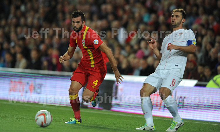 Joe Ledley of Wales and Celtic in action against Ivanovic of Serbia and Chelsea during the Wales v Serbia FIFA World Cup 2014 Qualifier match at Cardiff City Stadium, Cardiff, Wales -Tuesday 10th Sept 2014. All images are the copyright of Jeff Thomas Photography-07837 386244-www.jaypics.photoshelter.com