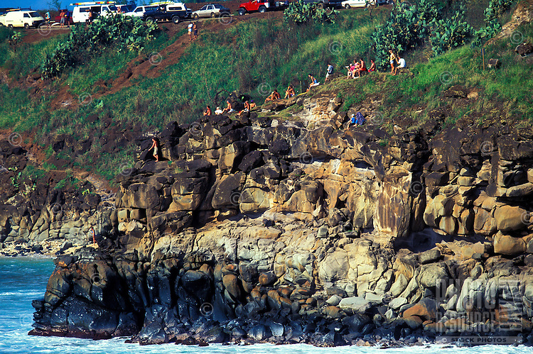 Spectators perched for a view of the surf in Honolua Bay on Maui