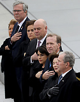 Former U.S. President George W. Bush (R) and his wife Laura watch as a U.S. military honor guard team carries the flag draped casket of former U.S. President George H. W. Bush from the U.S. Capitol December 5, 2018 in Washington, DC. A funeral service will be held today for former U.S. President Bush at the Washington National Cathedral. President Bush will be buried at his final resting place at the George H.W. Bush Presidential Library at Texas A&amp;M University in College Station, Texas. A WWII combat veteran, Bush served as a member of Congress from Texas, ambassador to the United Nations, director of the CIA, vice president and 41st president of the United States.<br /> Credit: Win McNamee / Pool via CNP / MediaPunch