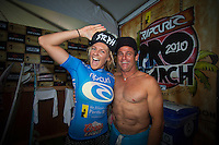 Stephanie Gilmore (AUS) with Taylor Knox (USA). SOMEWHERE, Porta Del Sol/Puerto Rico (Monday, November 1, 2010) - Stephanie Gilmore (AUS), 22, has claimed her fourth, consecutive ASP Women's World Title, making history at the Rip Curl Women's Pro Search Puerto Rico.. .With her Quarterfinal win over Melanie Bartels (HAW), 28, Gilmore amassed enough points to knock sole remaining contender, Sally Fitzgibbons (AUS), 19, out of the running for the 2010 ASP Women's World Title Race..Newly-crowned four-time ASP Women's World Champion Stephanie Gilmore (AUS), 22, has taken out her 16th elite tour event today, defeating rookie sensation Carissa Moore (HAW), 18, in two-to-three foot (1 metre) waves in Porta Del Sol to claim the Rip Curl Women's Search Pro Puerto Rico. .Photo: joliphotos.com