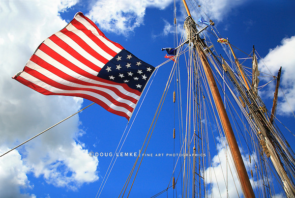 An American Flag, Mast And Rigging Against A Deep Blue Cloudy Sky During The Perry 200 Commemoration, September 2013, Erie Pennsylvania, USA