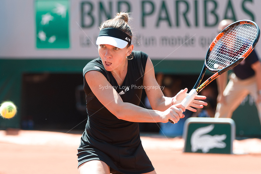 May 24, 2015: Simona Halep of Romania in action in a 1st round match against Evgeniya Rodina of Russia on day one of the 2015 French Open tennis tournament at Roland Garros in Paris, France. Halep won 75 64. Sydney Low/AsteriskImages