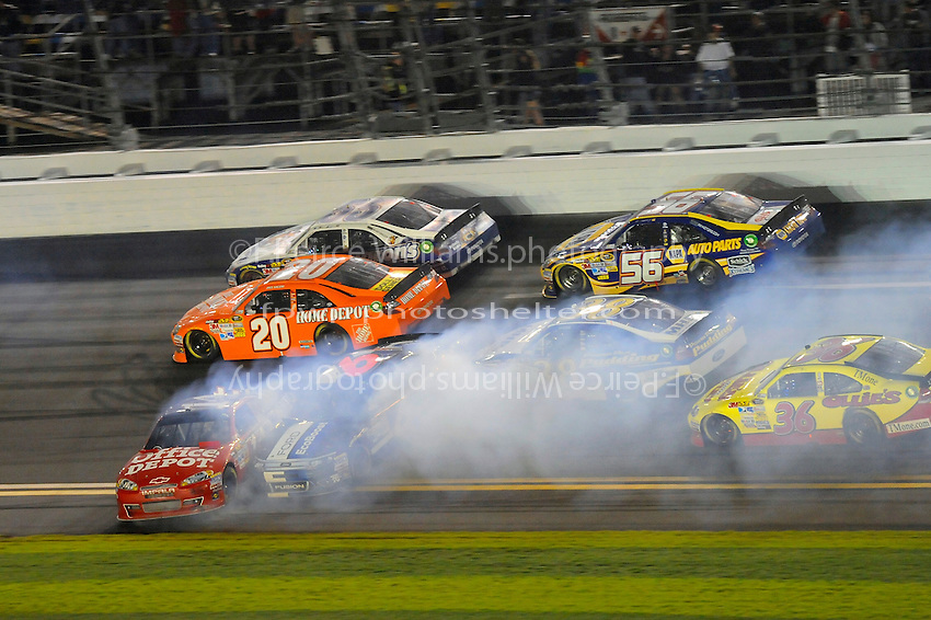 Frame 6: Racing 4 with into the tri-oval and with no where to go Ricky Stenhouse, Jr. (#6) gets into the back of Tony Stewart (#14) and spins him around as David Gilliland (#38), Joey Logano (#20), Mark Martin (#55), Dave Blaney (#36) and Martin Truex,Jr. (#56)look for a way past.