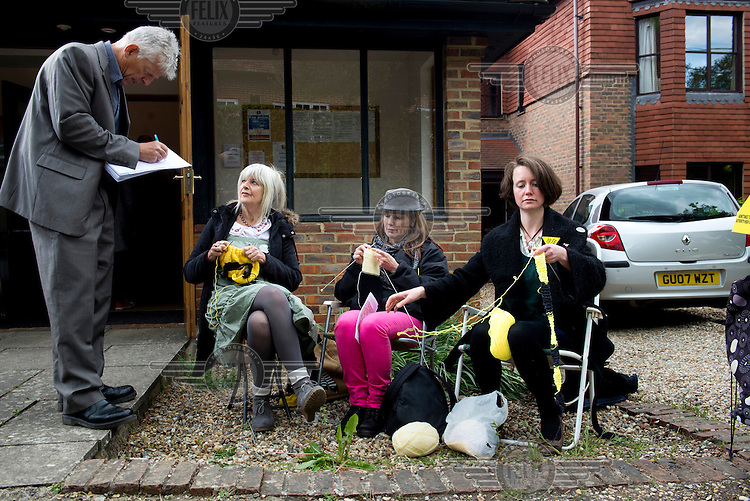 Members of the 'Knitting Nannas Against Gas' speak to a reporter outside a drop in meeting organised by Hydraulic Fracturing (fracking) company Cuadrilla Resources Ltd. The energy company have been granted an exploration licence for a site close to the village of Balcombe in West Sussex. /Felix Features