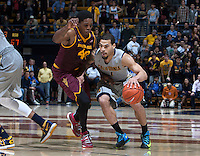Justin Cobbs of California in action during the game against Arizona State at Haas Pavilion in Berkeley, California on January 29th, 2014.   Arizona State defeated California, 89-78.