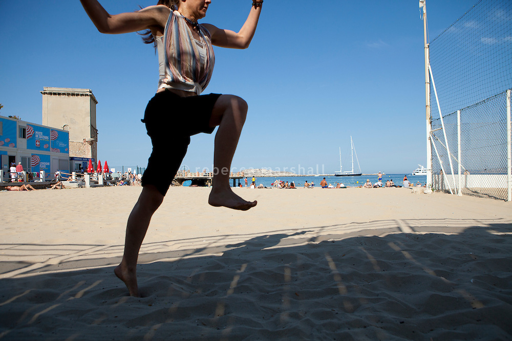 Maude practising Kalaripayattu, Plage des Catalans, Marseille, 16 June 2011. Kalaripayattu is a traditional Indian martial art and Maude practises here on the beach every morning.
