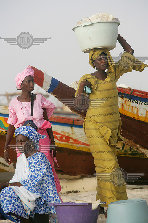 Women waiting for the fishing catch to come in. Mauritania has a long Atlantic coastline and is considered one of the richest marine fisheries in the world.