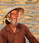 Vietnamese Boatman 02 - Vietnamese boatman in a small boat on the Thu Bon River, Hoi An, Viet Nam