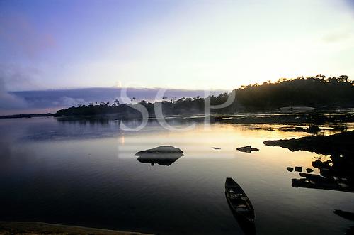 Xingu River, Amazon, Brazil. View of the  river near Tataquara with canoe.