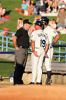 West Michigan Whitecaps coach Luis Quinones argues a call with umpire Matt Deane during a game vs. the South Bend Silver Hawks at Fifth Third Field in Comstock Park, Michigan August 16, 2010.   West Michigan defeated South Bend 3-2.  Photo By Mike Janes/Four Seam Images
