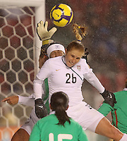 USA's Rachel Buehler (C) tries to head the ball into the goal as Mexico's goal keeper Erika Vanegas (B) grabs the ball at Rio Tinto Stadium March 31, 2010 in Salt Lake City, Utah. The USA women won the match over Mexico 1-0.