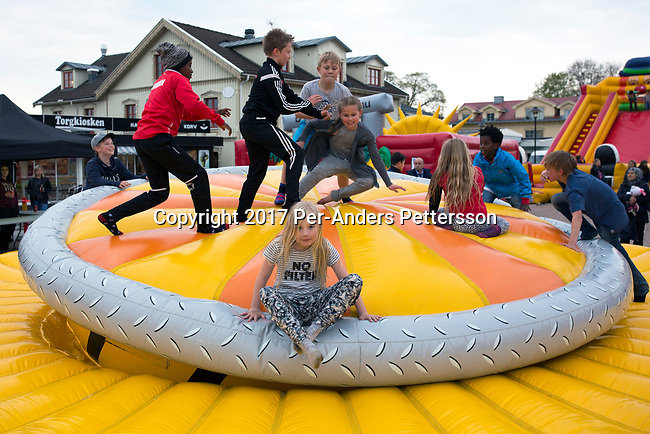SVENLJUNGA, SWEDEN - MAY 5: Children play in a jumping castle on May 5, 2017 in Svenljunga, Sweden. Sweden has seen a large influx of refugees the last few years, mainly from Africa and Middle East, and it has put strain on the Swedish economy. Sweden was recently ranked the best place in the world to be an immigrant, followed by Canada, Switzerland, Australia and Germany. (Photo by Per-Anders Pettersson/Getty Images)
