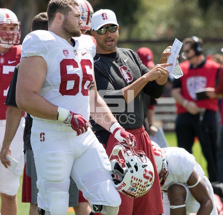 Stanford, CA - April15, 2017:  Harrison Phillips (66) Coach Diron Reynolds at Cagan Stadium.